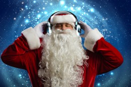 Santa Claus wearing headphones and enjoying music