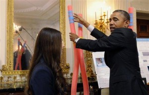 Self-effacing Obama hails science fair achievers