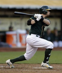 A's beat Yankees 5-1 after light outage delay