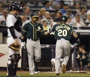 Cespedes homers twice, A's rally past Yankees 7-4
