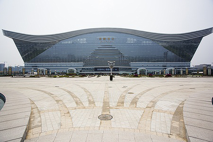 At 500 meters long, 400 meters wide, and 100 meters high, the New Century Global Center is the currently the largest freestanding building in the world and is located in Chengdu. he multifunctional building will be home to different types of business, including a IMAX Cineplex and an ice-skating rink which can accommodate international competitions.