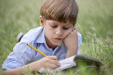 bigstock-Young-School-Boy-Doing-Homewor-40230784.jpg