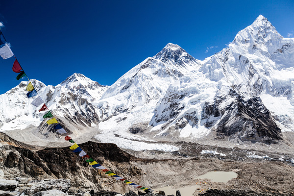 Everest with prayer flags in the foreground.