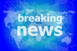 News And Press Concept: Words Breaking News On Digital Screen
