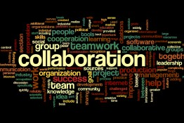 Collaboration concept in word tag cloud isolated on black backgr