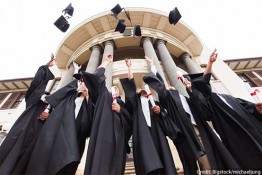 bigstock-group-of-happy-graduates-throw-credit
