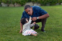 President Barack Obama plays with his niece Sevita during the family's vacation on Martha's Vineyard, Aug. 25 2009.  (Official White House Photo by Pete Souza)  This official White House photograph is being made available only for publication by news organizations and/or for personal use printing by the subject(s) of the photograph. The photograph may not be manipulated in any way and may not be used in commercial or political materials, advertisements, emails, products, or promotions that in any way suggests approval or endorsement of the President, the First Family, or the White House.