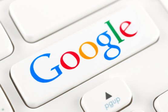 SIMFEROPOL RUSSIA - NOVEMBER 22 2014: Photo shoot of Google logotype on a keyboard button. Google is an American multinational corporation specializing in Internet-related services and products