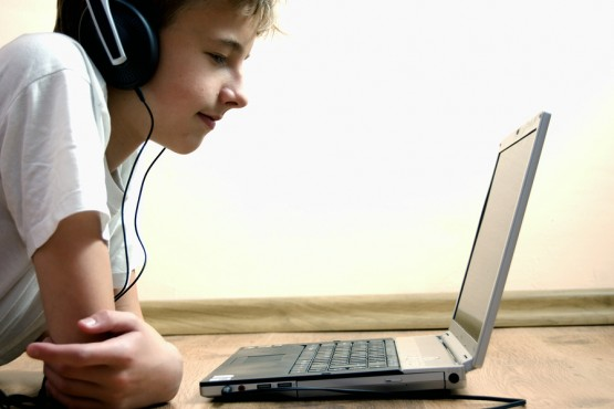 Boy spending time with notebook and modern technology