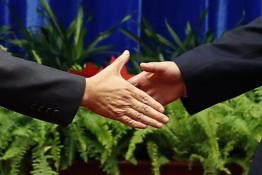 China's President Xi Jinping, right,  shakes hands with Japan's Prime Minister Shinzo Abe, during their meeting at the Great Hall of the People, on the sidelines of the Asia-Pacific Economic Cooperation (APEC) meetings, in Beijing, Monday, Nov. 10, 2014. An uneasy handshake Monday between Xi and Abe marked the first meeting between the two men since either took power, and an awkward first gesture toward easing two years of high tensions. (AP Photo/Kim Kyung-Hoon, Pool)
