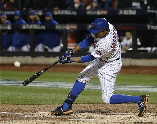 New York Mets' Curtis Granderson hits an RBI sacrifice fly to score Wilmer Flores during the third inning of Game 4 of the Major League Baseball World against the Kansas City Royals Series Saturday, Oct. 31, 2015, in New York. (AP Photo/Matt Slocum)