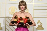 """Taylor Swift poses in the press room with the awards for album of the year for 1989, pop vocal album for 1989 and best music video for """"Bad Blood"""" at the 58th annual Grammy Awards at the Staples Center on Monday, Feb. 15, 2016, in Los Angeles. (Photo by Chris Pizzello/Invision/AP)"""