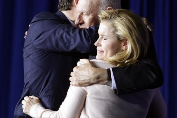 Republican presidential candidate, Sen. Ted Cruz, R-Texas, hugs his wife, Heidi, and his father, Rafael, following a primary night campaign event, Tuesday, May 3, 2016, in Indianapolis. Cruz ended his presidential campaign, eliminating the biggest impediment to Donald Trump's march to the Republican nomination. (AP Photo/Darron Cummings)